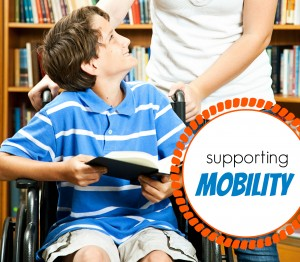 Teen girl and disabled boy in the school library
