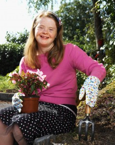 teenage girl (14-17) with down syndrome gardening
