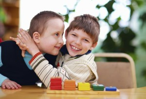 two boys hugging with colored blocks