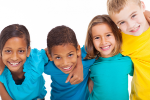 kids in multicolored shirts smiling