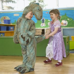 preschool students in costume dinosaur princess play time